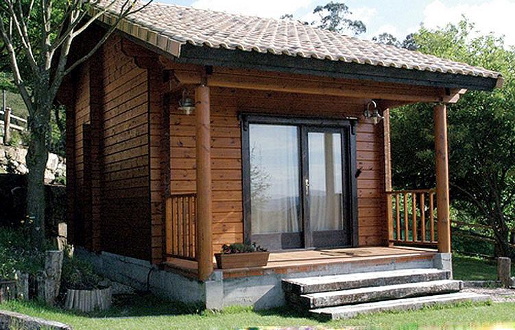 Fachadas de caba as peque as for Casas de madera pequenas