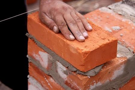 la construcción de edificios de mampostería de ladrillo